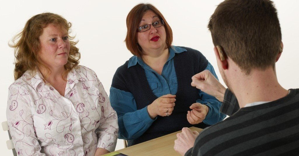 Communicating through a British Sign Language (BSL) interpreter