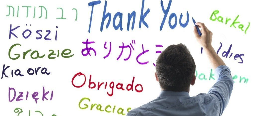 "Man makes a written translation of the word ""Thank you"""
